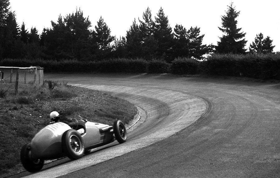 Jean Behra drives his Gordini Type 16 through the Karussell, German Grand Prix, Nurburgring, August 3, 1952